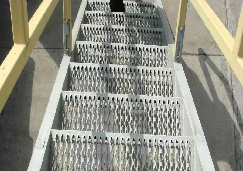 Diamond safety gratings are installed as the stair treads.