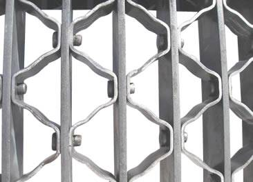 A riveted aluminum steel grating on the white background.