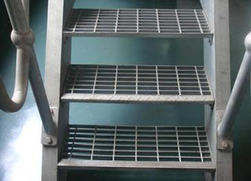 Three stair treads are made of aluminum steel grating.