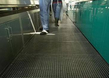 Two man is walking on the carbon steel grating walkways.