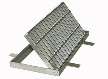 A hinged drainage trench box grate with cross bars on the frame.