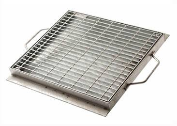 A drainage trench box grate with two handle on the frame.