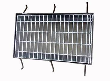 A galvanized drainage trench box grate with six supporting bars.