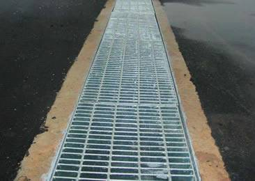 The angle frame is embed into the ground and the welded grates is covering the drainage.