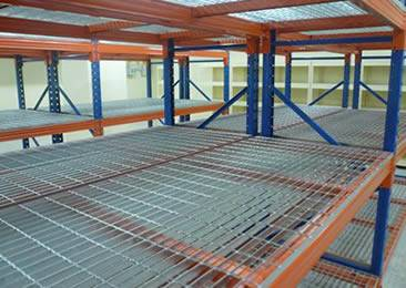 A temporary parking lot is made of platform grating and frames.