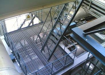 A steel structure with a platform and several stair treads.