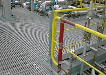 The platform is made of platform grating and several pipeline on it.