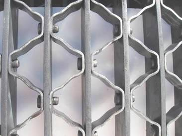 An aluminum riveted grating on the table.