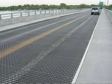 Several riveted grating is covering the bridge surface.