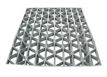 A riveted steel grating with serrated surface.