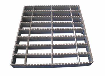 A swage-locked grating with serrated surface on the white background.