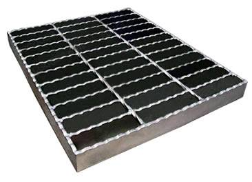 A welded steel grating with serrated surface on the white background.