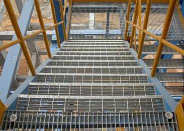 Several Steel Grating Stair Treads Are Installed In The Construction Site.