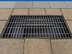 A drainage cover is installed on the ground.
