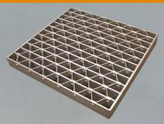 A riveted steel grating on the white background.