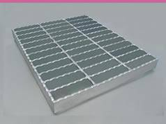 A serrated steel grating on the white background.