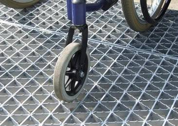 Three wheels is placing on the riveted walkway grating.